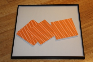 I used a basic large square frame, and I found some patterned origami paper during the study clean-out last week, so I used that too.